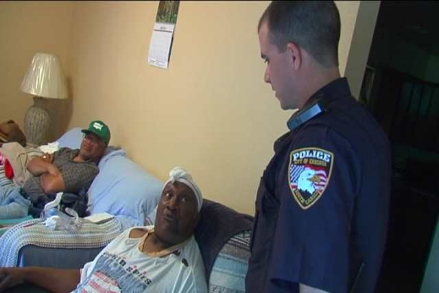 Chesnee officer Tim Walker talks with Frederick Watkins at his home (May 15, 2014/FOX Carolina)