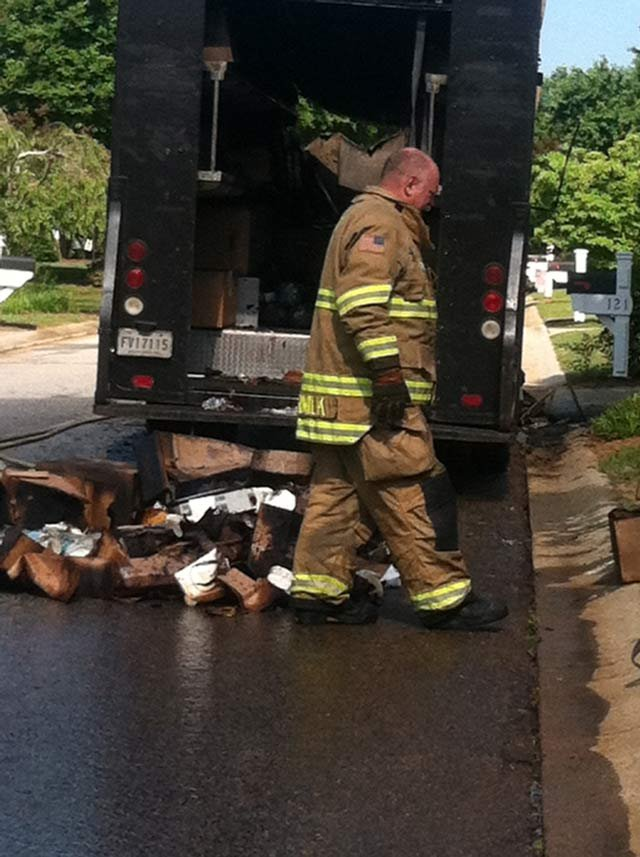 Firefighters clean up the UPS truck fire debris. (May 19, 2014/Angel Jaramillo)