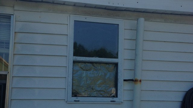 Deputies said they were called to the home where the victim claimed she was partially undressed in her bathroom when she thought she saw someone trying to record video of her though this bathroom window. (May 28,2014/FOX Carolina)