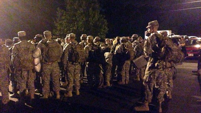 The troops gather to board buses headed to Fort Bliss. (May 30, 2014/FOX Carolina)