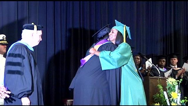 """Michael """"Tank"""" Anderson's mom accepts his diploma. (June 3, 2014/FOX Carolina)"""
