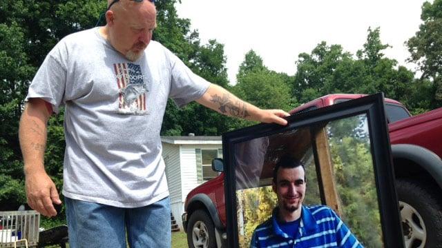 James Howard with a photo of his stepson Jordan Browder. (June 5, 2014/FOX Carolina)