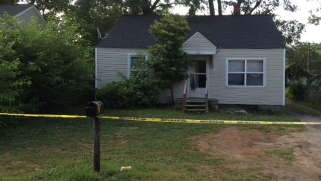 Investigators work to find shooting scene, roping off Allen Ave. home. (June 9, 2014/FOX Carolina)