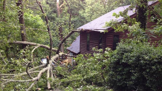 A downed tree atop a Westview Ave. home. (June 11, 2014/FOX Carolina)