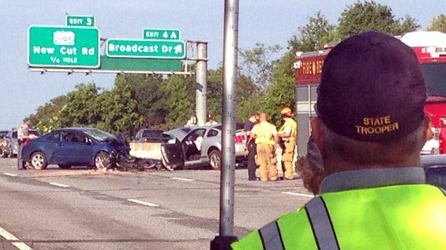 Emergency crews investigate the I-85B crash. (June 13, 2014/FOX Carolina)