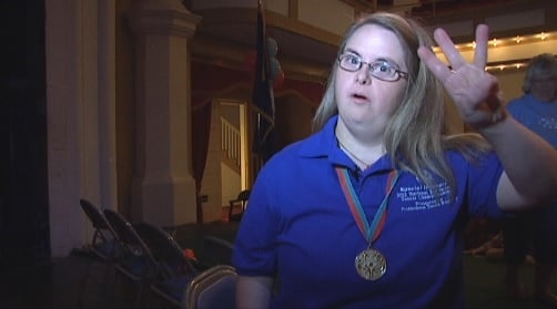 Ashley Bond holds up three fingers for the three medals she hopes to win. (FOX Carolina)