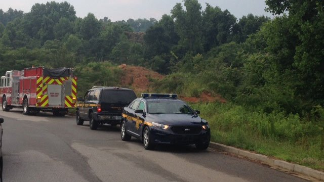 Deputies found a man dead in the wooded area off the road. (June 16, 2014/FOX Carolina)