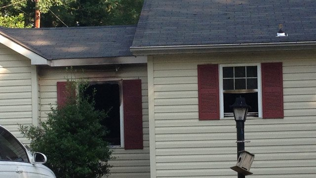 Fire damaged windows of the Overbrook Circle home. (June 17, 2014/FOX Carolina)