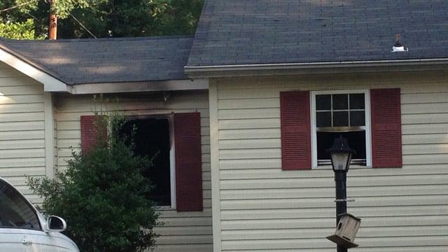 Fire damaged windows of the Overbrook Circle home. (June 17, 2014/FOX Carolina)