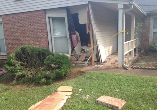 House on Charterhouse Ave. damaged in hit-and-run (FOX Carolina)