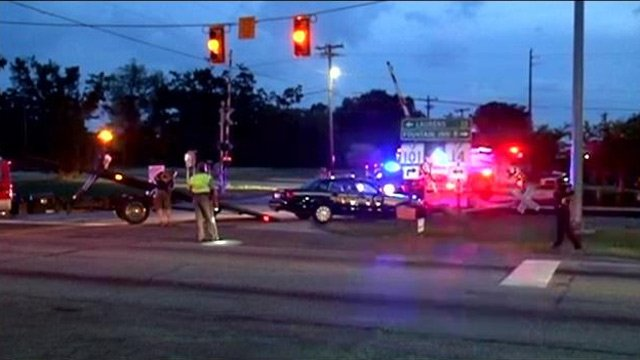 The deputy's patrol car is towed away from the crash scene. (June 23, 2014/FOX Carolina)