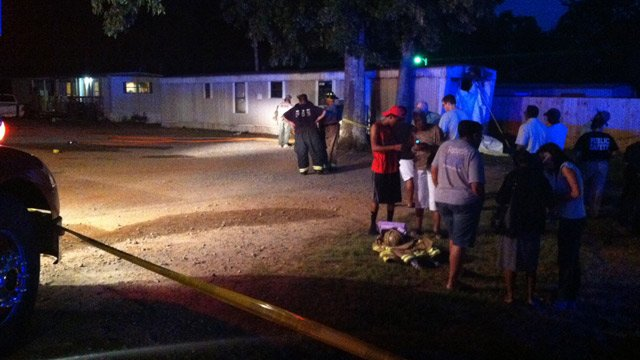 Many gathered outside the woman's mobile home after the fire on Monday. (June 23, 2014/FOX Carolina)