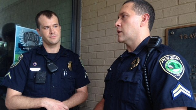The two Travelers Rest police officer, Nodine (L) and Johnson, who pulled the driver from the fiery crash. (June 24, 2014/FOX Carolina)