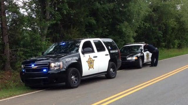 Deputies respond to Ezell and Buck Creek roads near where the body was found. (June 24, 2014/FOX Carolina)