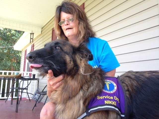 Joanne Powner and her service dog Nikki (Fox Carolina 2014)