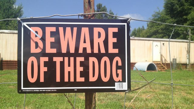 A sign outside of the boxer-pit bull-mix owner's home. (July 1, 2014/FOX Carolina)