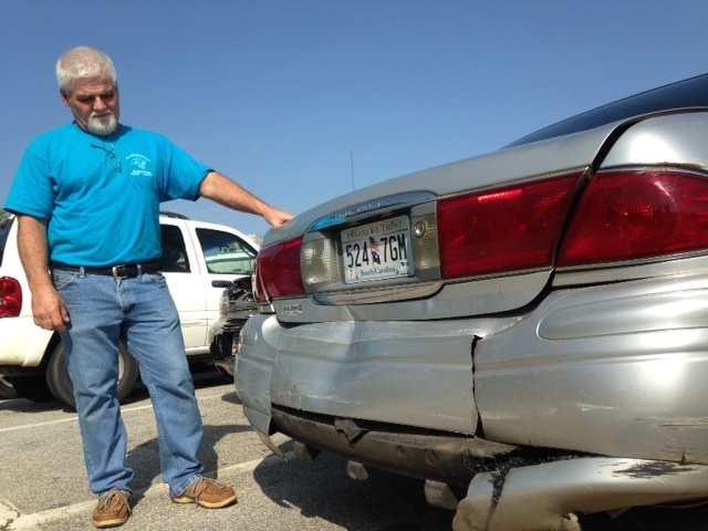 George Brown shows the damage to his car. (Fox Carolina, 2014)