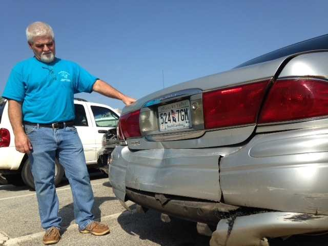 George Brown shows the damage to his car. (Fox Carolina, 2014)