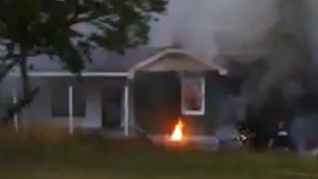 Flames and smoke surround the home. (July 3, 2014/FOX Carolina iWitness Jonathan P.)