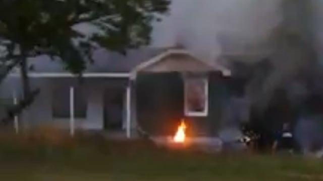 Flames and smoke surround the home. (July 3, 2014/FOX Carolina iWitness Jonathan P.)