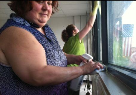 Volunteers clean ahead of cats' arrival. (July 6, 2014/FOX Carolina)