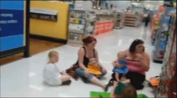"A still from cell phone video taken inside the store during the ""nurse-in."""