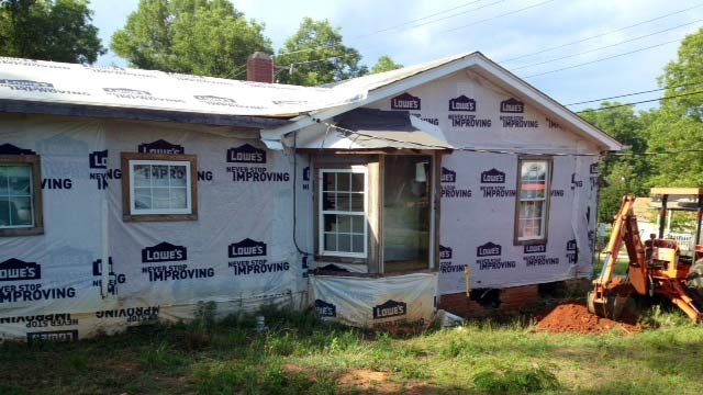 The car struck this house following a chase on Wednesday. (July 9, 2014/FOX Carolina)