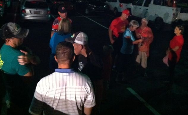 Group cheers on cyclist, Dave Nazaroff, who stopped in Spartanburg Thursday night. Nazaroff is riding to raise money for a Florida girl with a rare disease.