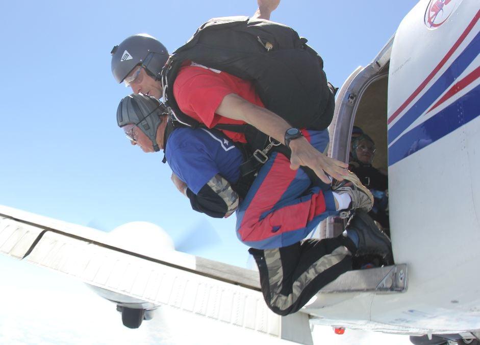 Conrad Lipscomb (blue shirt) makes a tandem jump over Chester County (Courtesy: Skydive Carolina))