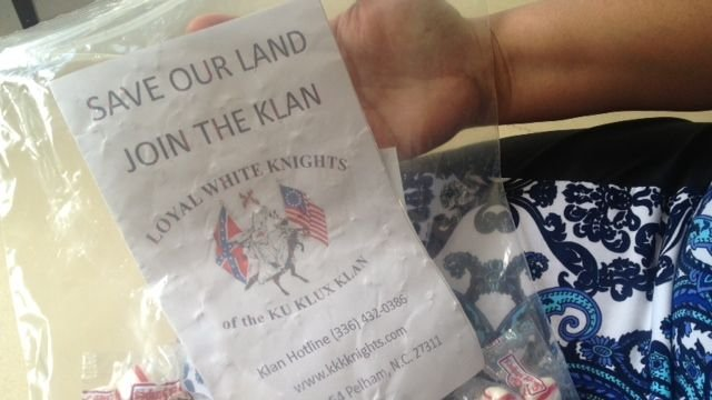 The flyer and bag of candy dropped in a Seneca woman's driveway. (July 14, 2014/FOX Carolina)