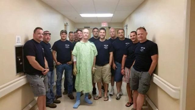 Patrick Schultz gets a visit from firefighter friends. (Courtesy: Schultz family)