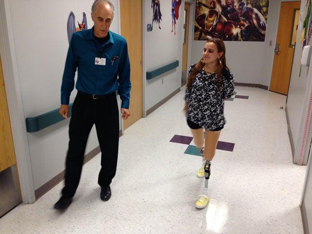 Salee Allawe walks with her new prosthetics. (July 16, 2014/FOX Carolina)