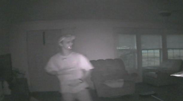 Surveillance footage shows Thomas Grant inside Travis Garrett's home, police say. (Source: Garrett Family)