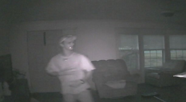 Surveillance footage shows Thomas Grant inside Travis Garrett's home, police say. (Source: Garrett Family)