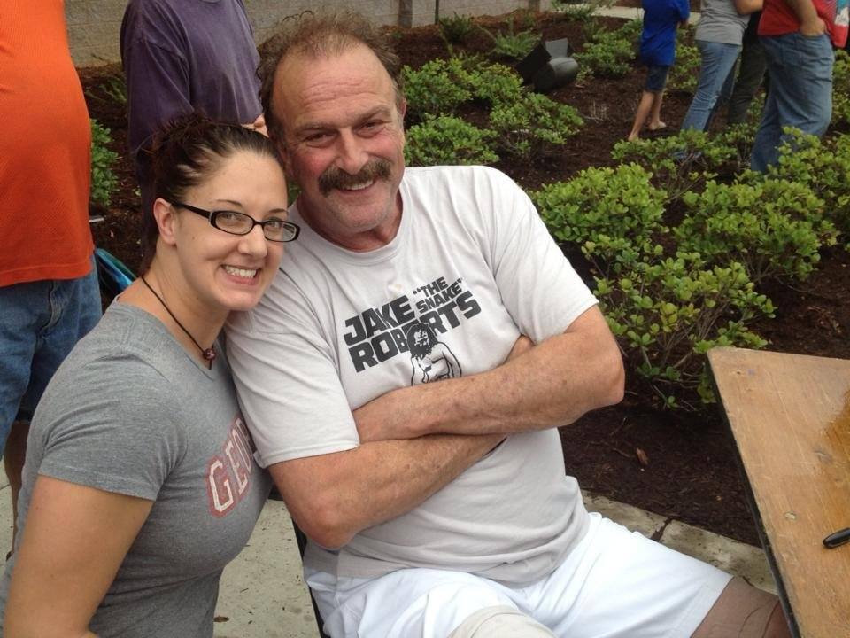 jake the snake roberts poses for a photo with fox carolina photojournalist mindy cecil