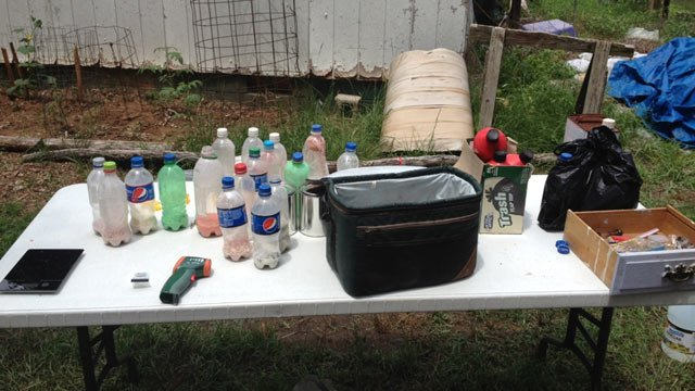 """Deputies said """"shake-and-bake"""" meth labs were found in an outbuilding at the home. (Source: Greenwood County Sheriff's Office)"""