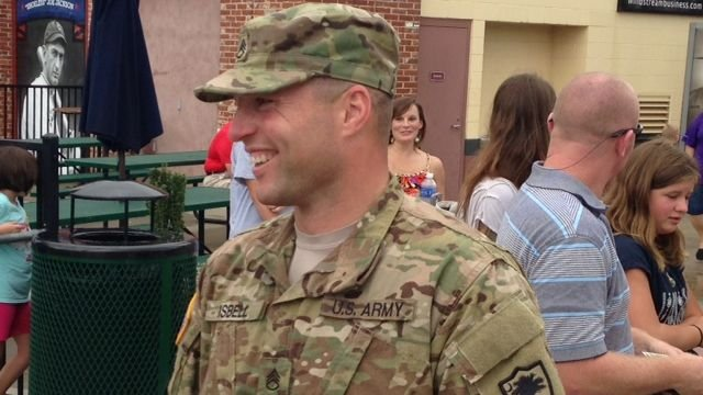 Staff Sgt. Michael Isbell after catching the first pitch at Monday's game. (July 22, 2014/FOX Carolina)