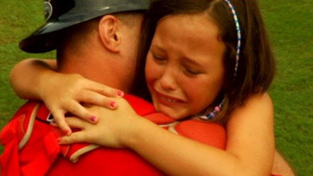 Cami Lee with her dad after he surprised her with his return home. (July 22, 2014/FOX Carolina)