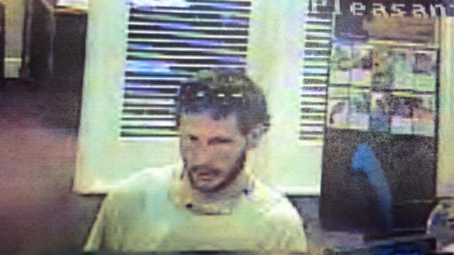 Police released surveillance images of the suspect from the robbery. (Source: Greenville PD)