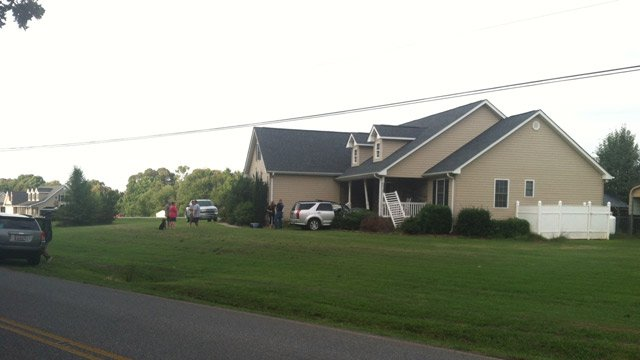 The SUV hit the home on Meadowood Drive in Anderson County.  (July 27, 2014/FOX Carolina)