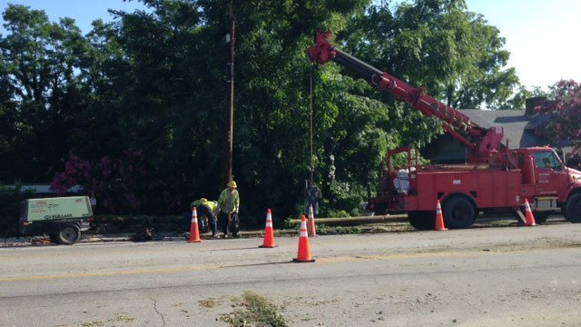 Utility crews are working to repair a damaged power pole on Haywood Road. (July 28, 2014/FOX Carolina)
