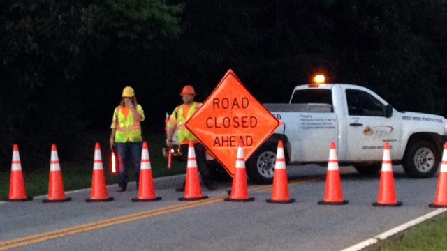 Utility crews block Highway 81 to traffic after crash, downed power lines. (July 29, 2014/FOX Carolina)