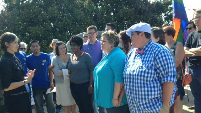 Same-sex couples, friends, family and supporters gather outside Greenville Co. County Square. (July 30, 2014/FOX Carolina)