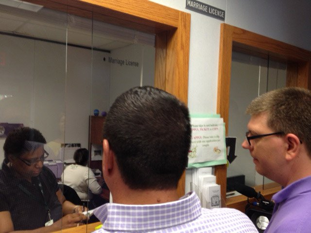 A couple applies for a marriage license at Greenville Co. County Square. (July 30, 2014/FOX Carolina)