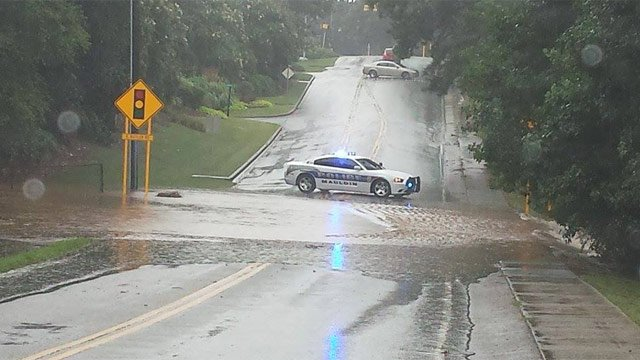 Mauldin police block off a flooded Bethel Road. (July 31, 2014/O. Blackwell)