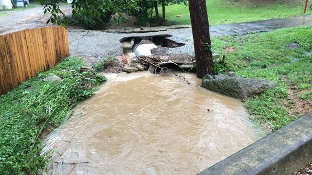 Rising waters damage roadway into evacuated mobile home park in Mauldin. (July 31, 2014/FOX Carolina)