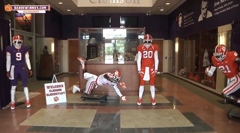 Cole Stoudt wears the no. 20 jersey pretending to be a mannequin. (Source: YouTube/Clemson Tigers)