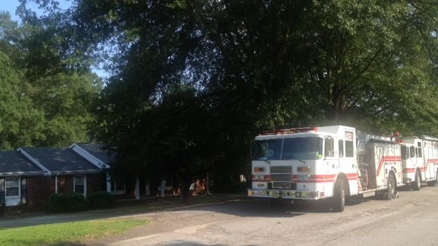 Spartanburg firefighters work on the renovated home for a disabled Vietnam veteran. (Aug. 4, 2014/FOX Carolina)