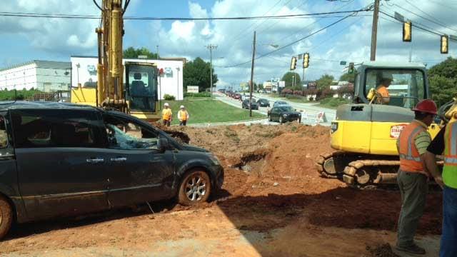 Crews at work on Haywood Road (FOX Carolina)