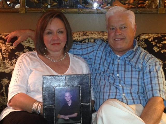 Lynn and Marion Terry with a picture of their late son, Bryan. (Aug. 12, 2014/FOX Carolina)